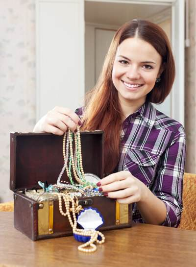 happy girl chooses jewelry